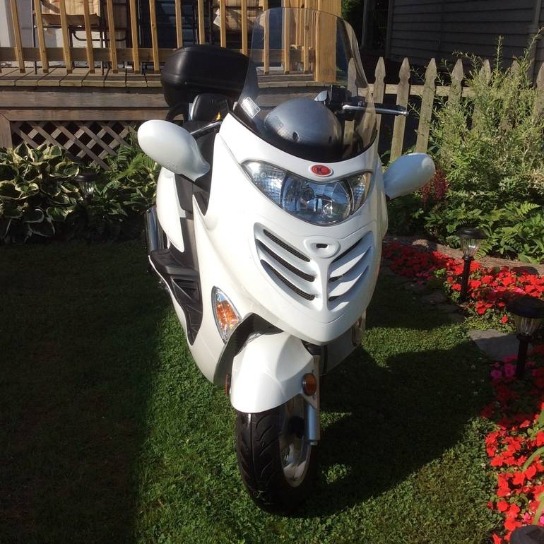 See more photos for this Kymco Grandvista 250, 2008 motorcycle listing